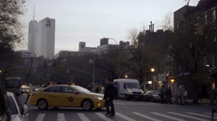 Yellow taxi cab turning corner onto 6th Ave evening Manhattan NYC Stock Footage