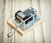Old little music box on the wooden background, retro style - stock photo