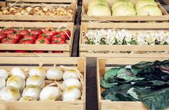 Various vegetable in wooden containers, rural marketplace Stock Photos
