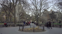 Washington Square Park East entrance on cold fall winter day with bare trees NYC Stock Footage