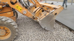 Bulldozer spreads gravel on the territory Stock Footage