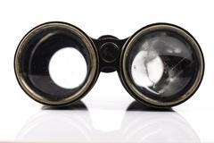Old vintage binoculars closeup on white background Stock Photos