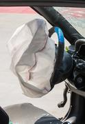 Exploded airbag - stock photo