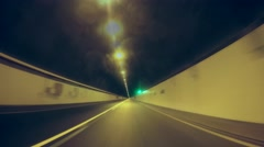 Time-lapse POV - driving in a tunnel Stock Footage