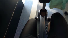 Male legs riding stationary bike in gym, super slow motion 120fps Stock Footage