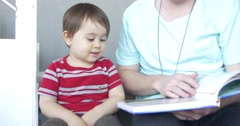 Father reads story to half Japanese son 4K - stock footage