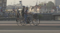 Guys biking in Amsterdam - ungraded: c-log Stock Footage