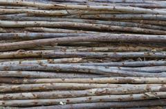 Lumber pile at construction site - stock photo