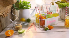 Refreshing lemonade with fresh fruits in summer - stock footage