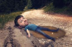 Man in the puddle - stock photo