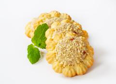 Flower-shaped spritz cookies with peanut butter centers Stock Photos