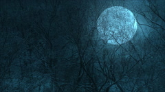 A huge moon through the trees over a precipice Stock Footage