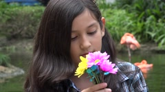 Hispanic Young Girl with Flowers Stock Footage
