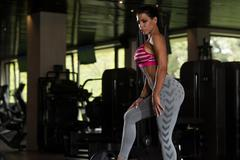 Sexy Mexican Woman Resting In The Gym - stock photo