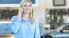 Pleasing female customer talking happily on the phone Stock Footage