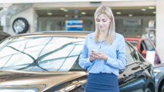 Attractive young lady is texting on her smartphone Stock Footage