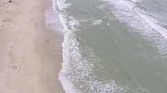 Aerial slow motion shot of sea tide on a sandy beach - stock footage