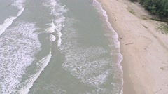 Aerial slow motion video of sea surf and sandy beach - stock footage