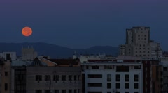 City sunset with moon going down (timelapse) Stock Footage