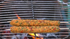 Man grilling kabab on barbecue Stock Footage