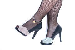 Beautiful female legs with black heels on white background - stock photo