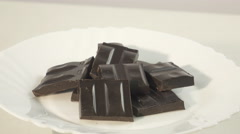 Dark chocolate on a saucer Stock Footage