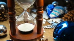 Wooden hourglass measures time till holiday. Stock Footage