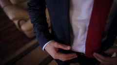 the groom in a blue suit jacket buttoning on - stock footage