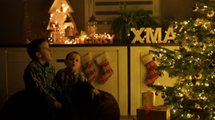 little boys singing on christmas eve at home - stock footage
