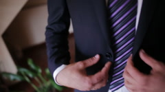 A man in a blue suit jacket buttoning on Stock Footage