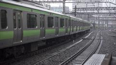 Yamanote Line Train Departs Ueno Station - stock footage