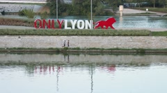 "Joggers near ""Only Lyon"" symbol in Lyon (France) Stock Footage"