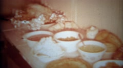 1966: Table of party food spread with chips dips breads olives grapes and soup. - stock footage