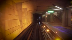 Subway going in dark tunnel. Empty station - stock footage