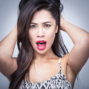 Beautiful Woman Surprsised Shocked Amazed - stock photo