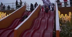 Kids Happy Children Are Going Down The Red Chute at the Sofia Square People are Stock Footage