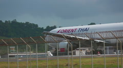 Boeing 767 taxiing at Phuket International Airport. Stock Footage