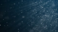 Seamless background of small particles floating underwater Stock Footage