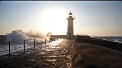 Lighthouse Felgueirasin Porto with waves and sun at sunset Stock Footage