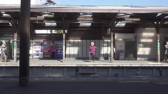 Enoden Train Arrives at Hase Station in Kamakura, Japan - stock footage