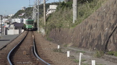 Enoden Train in Kamakura, Japan - stock footage