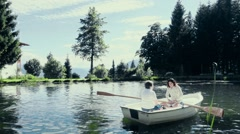 Women paddling boat on artificial lake Stock Footage