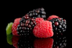 Blackberry and raspberry Stock Photos