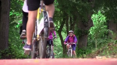 Group of bicyclists make a halt in the woods while other riders passed by the Stock Footage