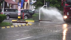 Stock Video Footage of Heavy truck that spread water from puddles while driving