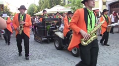Music band playing on the street chased by young and old throng 5 Stock Footage