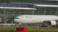 Thai Airways Boeing 777 HS-TKD named Thepali taxiing. - stock footage