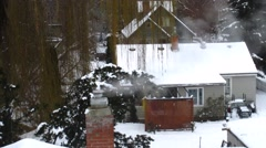 Cooking steam /smoke over snowy house in winter Stock Footage