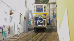 Vintage Lisbon lift (elevator) painted with graffiti on city street Stock Footage