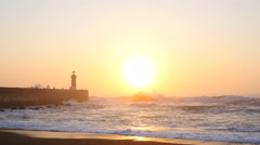 Lighthouse Felgueirasin Porto with waves and sun at sunset, timelapse - stock footage